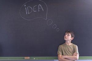 Idea concept write on the blackboard
