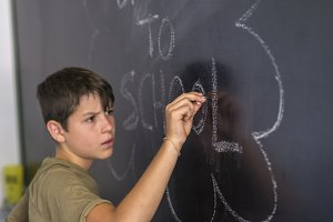 """Young teen and blackboard with """" bac"""