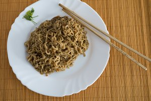 Noodles with beef in rectangle plate