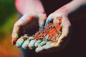 Dirty woman's hands with colorful po