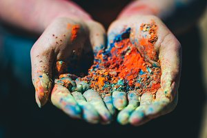 Holi powder held in woman's hand. Cl