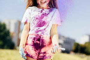 Little girl playing with holi powder