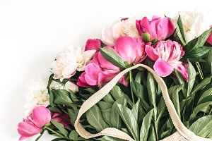 Peony flowers in string bag