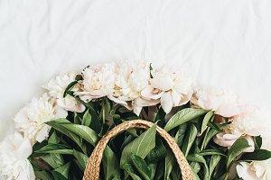 Peony flowers in straw bag