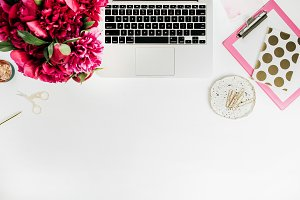 Workspace with laptop and peonies