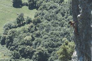 Mature woman climber climbing