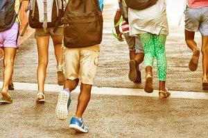Rear view of classmates running