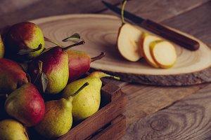 fresh pears with leaves in a wooden