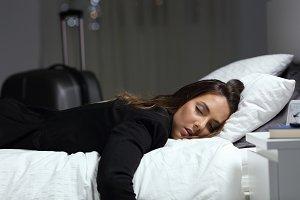 Tired business traveler sleeping