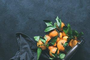 Mandarines or tangerines with leaves