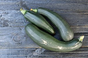 three green courgettes