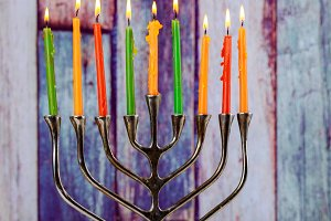 Hanukkah menorah with burning candle