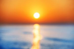 Blur abstract sunset over sea