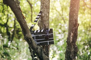 Black clapperboard with glasses