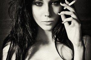 Pretty young woman smoking cigarette