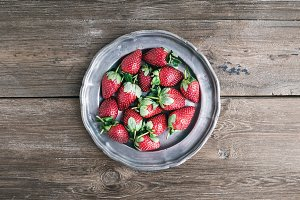 Strawberries on vintage metal plate