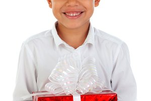 Small child with a red present
