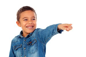 Cute kid pointing with his finger at