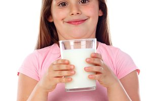 Adorable child drinking milk