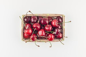 Fresh ripe cherry in a small wicker