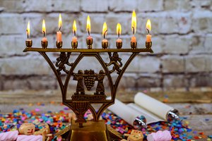 Bronze Hanukkah menorah with burning