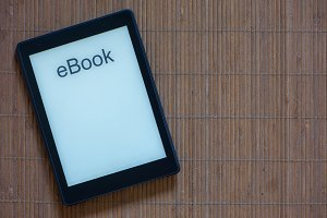 An e-reader with white screen and te