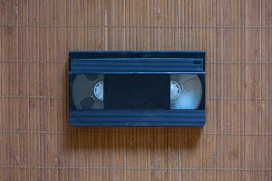 An old cassette tape of a black colo