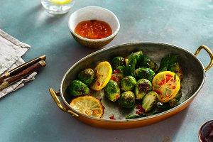 Fried broccoli zucchini served pan