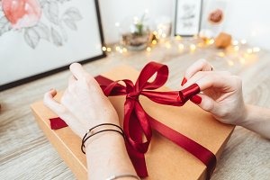 Woman wrapping present in paper with