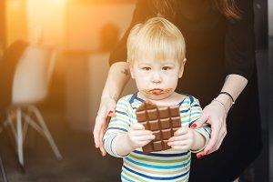 Portrait of an littel boy eating cho