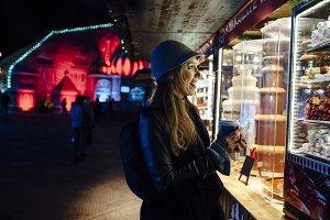 Young woman at funfair at night