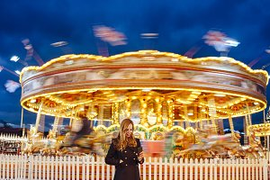 Woman using smartphone at funfair