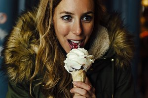 Young blonde woman eating ice cream