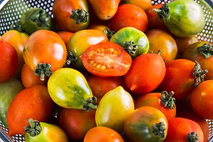 Italian tomatoes in a colander on ta