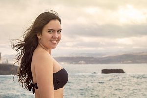 Smiling woman in black bikini.