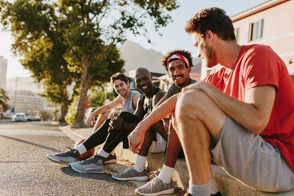 Sports Stock Photos: Jacob Lund Photography - Athletes sitting on the pavement