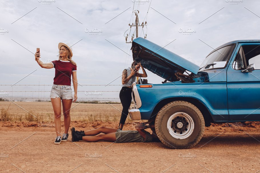Women With Broken Down Car On Road People