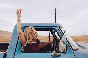 Beautiful woman enjoying driving