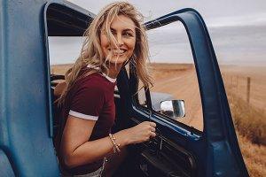 Woman enjoying herself on road trip