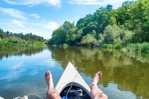 A man relaxing on kayak
