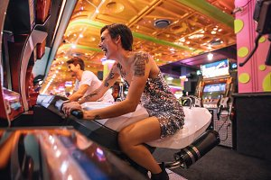 Couple playing an arcade racing game