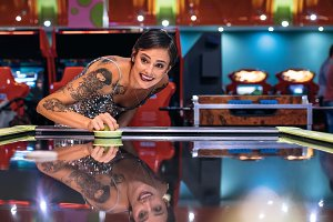 Woman playing air hockey game