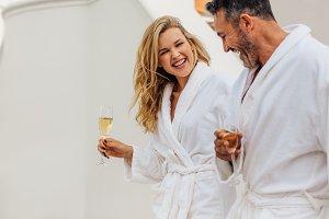 Cheerful couple in bathrobe