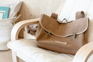 Brown suede backpack in the armchair