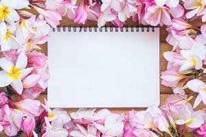 blank paper with flower on table