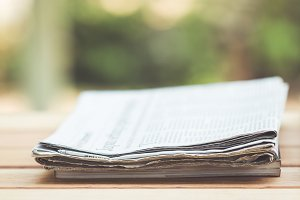 Daily newspaper on the wooden table