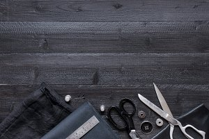 Black wooden sewing background