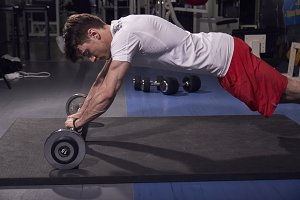one young man, exercise barbell roll
