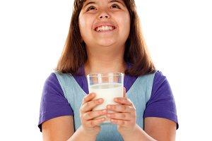 Adorable child drinking milk
