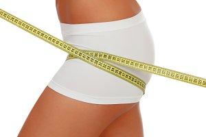 Beautiful body woman measuring her b